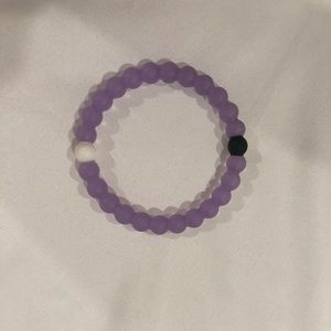 Purple Lokai bracelet.